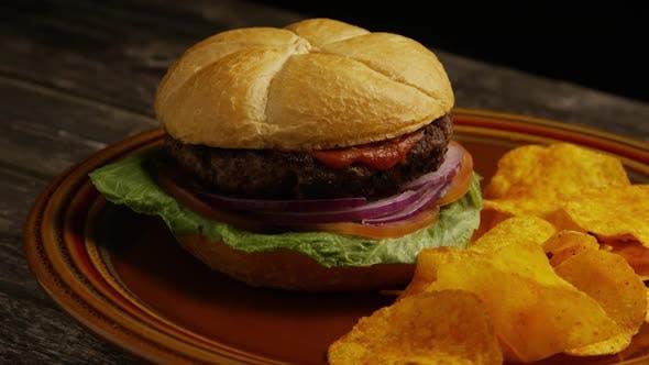 Thumbnail for Rotating Shot of Delicious Burger and Potato Chips