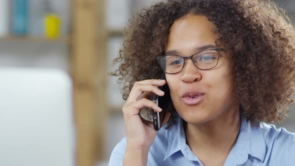 Thumbnail for Cheerful Young Woman Talking on Phone