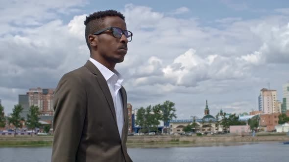 Thumbnail for Successful Businessman Walking along Riverside