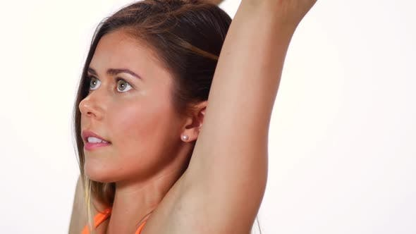 Cover Image for Young Attractive Female Doing A Yoga Pose Balancing And Holding One Leg Behind Her Head