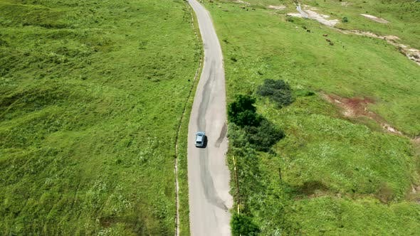 Thumbnail for Top Down View of Car on Rural Road