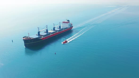 Thumbnail for AERIAL VIEW: Flying Over Massive Ship Filled Moving in the Quiet Sea. Cargo Being Moved By Large