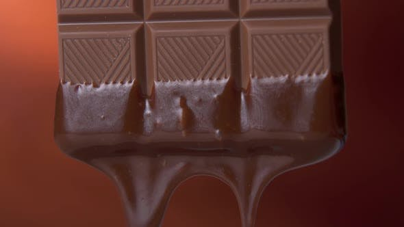 Thumbnail for Chocolate Bar with Melted Dark Chocolate Dripping on a Brown Background