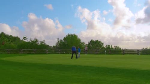 Granddad with His Grandson Golfers Playing on Perfect Golf Course. Timelapse