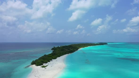 Daytime overhead copy space shot of a paradise sunny white sand beach and blue water background in h