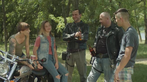 Thumbnail for Diverse Bikers Relaxing After Motorbike Ride