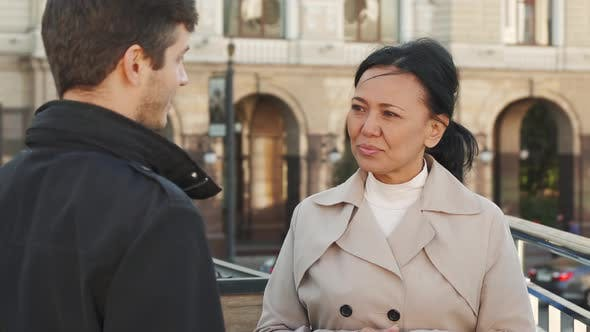 Thumbnail for Cheerful Woman Is Talking with a Young Man