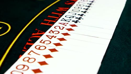 Camera Moves Across Deck of Cards on Poker Table, Closeup