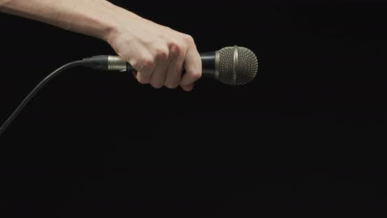 Thumbnail for Hand dropping the microphone