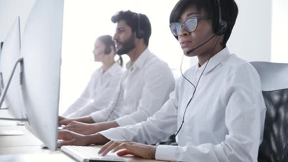 Call Center. People In Headsets Working At Customer Support