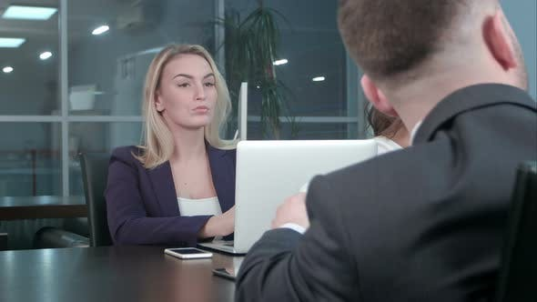 Young blond businesswoman working communicate with colleagues