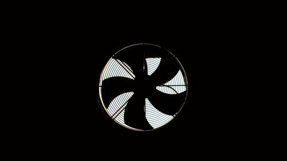 A Hood with a Fan Is Installed in a Dark Room. The Blades Are Spinning