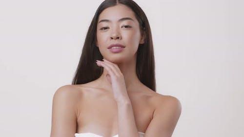 Beauty Portrait of Attractive Asian Girl Posing in Towel