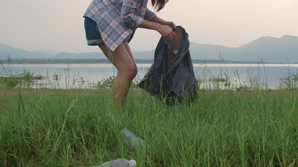 Korean lady volunteers help to keep nature clean up and pick up garbage
