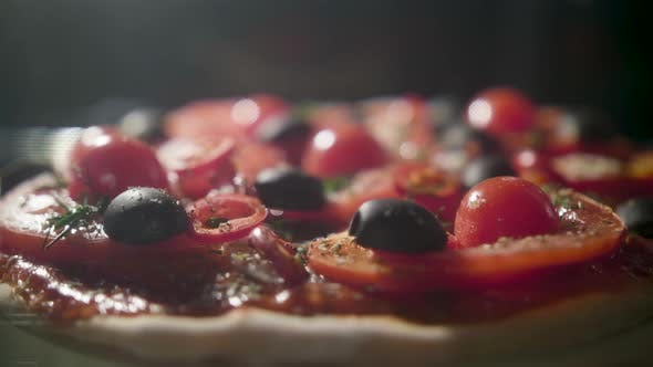 Thumbnail for Timelapse of Vegetarian Pizza Baking Full Heated Oven