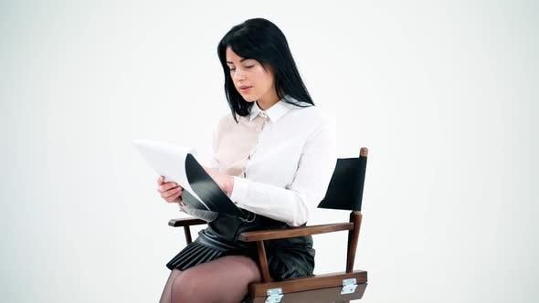 Beautiful brunette reading documents