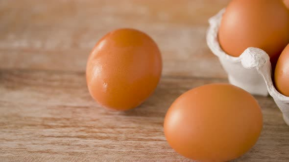Thumbnail for Close Up of Eggs in Cardboard Box on Wooden Table
