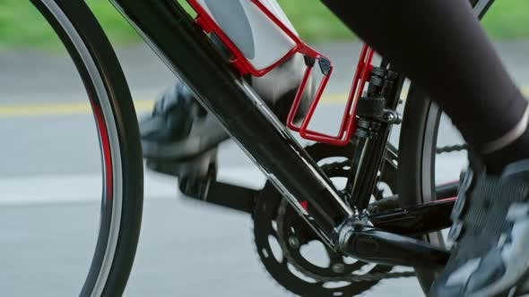 Thumbnail for Unrecognizable Person Pedaling Bicycle