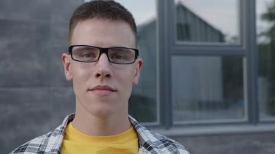 Man in Yellow Black Glasses