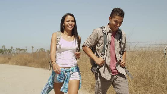 Thumbnail for Happy Hispanic couple hiking together