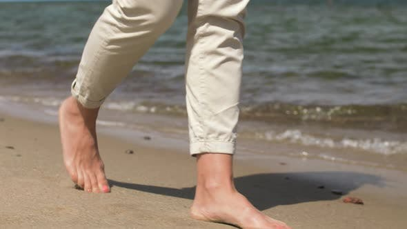 Thumbnail for Woman Feet Walking Barefoot Along Summer Beach 10