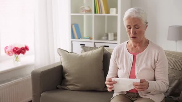 Thumbnail for Sick Senior Woman Blowing Nose To Paper Napkin