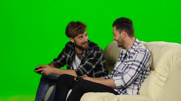 Thumbnail for Men Compete in the Game on the Console. Green Screen