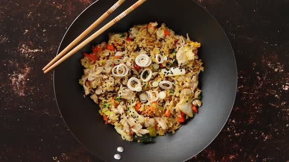 Delicious Fried Rice with Chicken in Wok
