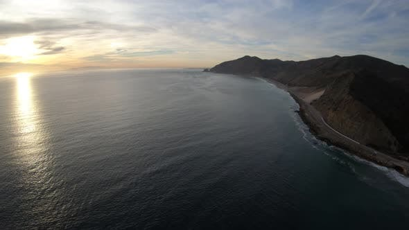 Thumbnail for Flying Along Coastline Of Santa Monica Mountains Near Sand Dunes And Pacific Coast Highway