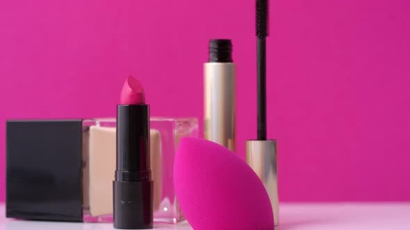 Thumbnail for Decorative Cosmetics and Make Up Sponge on Pink Background