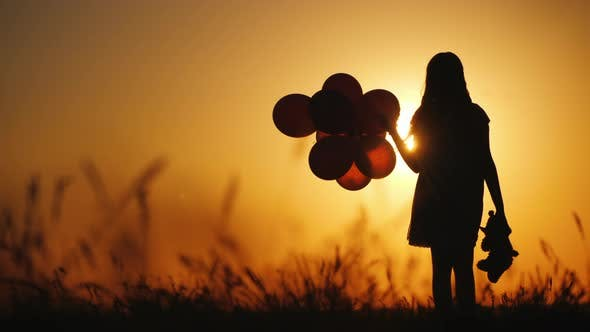 Thumbnail for Silhouette of a Girl with Balloons and a Teddy Bear