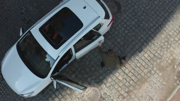 Thumbnail for Aerial View of Driver Pulling Criminal Out of Car