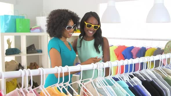 Thumbnail for African American friends shopping and taking pictures with mobile phone