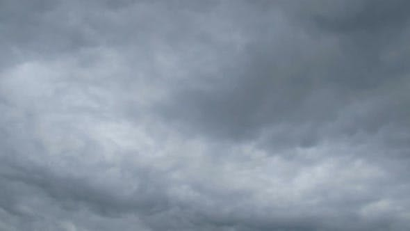 Thumbnail for Gray Rain Clouds Are Moving in the Sky. TimeLapse