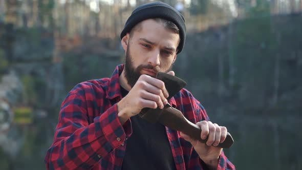 Thumbnail for Bearded Young Man Look at His Axe Brutal Serious Guy with Ax Outdoors
