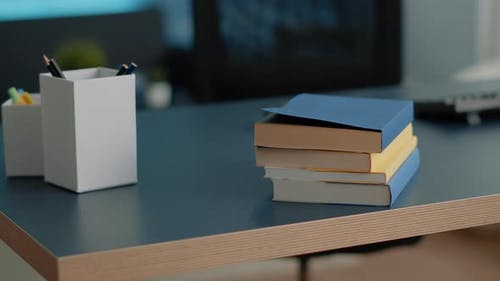 Close Up of Desk with School Books for Education and Studying