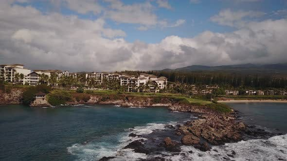 Beautiful Aerial Panorama of Most Expensive Resort Montage Kapalua and Bursting Waves of Ocean on