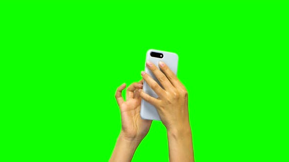 Thumbnail for Hands Are Using White Smartphone, Green Screen Background