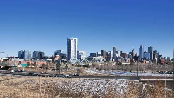 Cover Image for Denver Traffic Downtown Skyline Office Buildings Architecture Background