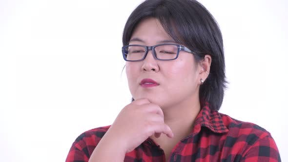 Thumbnail for Face of Happy Overweight Asian Hipster Woman Thinking and Looking Up