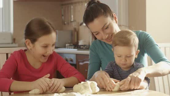 Thumbnail for Portrait of Daughter Son Helping Mother To Cook Kneading Dough Happy Family Spending Time Together