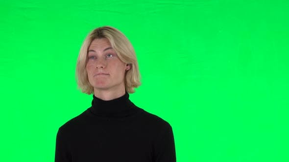 Thumbnail for Blonde Guy Negatively Waving His Head and Smiling. Green Screen