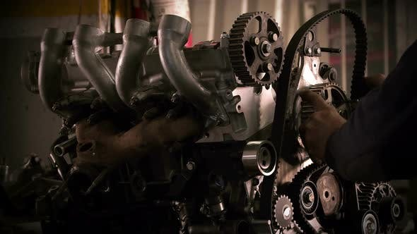 Thumbnail for Car Mechanic Wears Timing Belt 2
