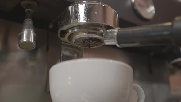Thumbnail for Pouring Coffee Stream From Professional Machine in Cup. Flowing Fresh Ground Coffee. Drinking