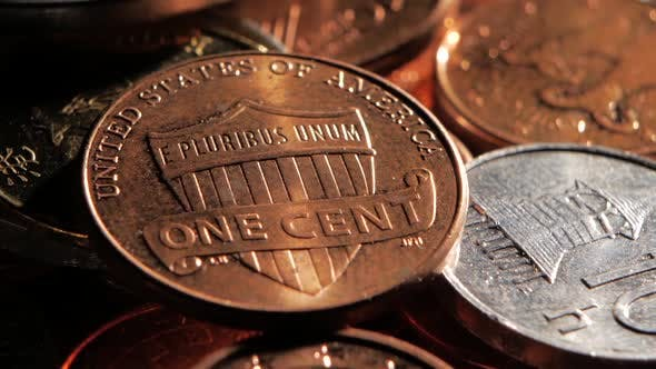 Thumbnail for One Cent Is on Top of the Pile. Close Up