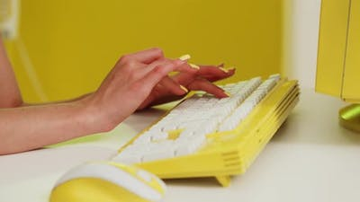 Woman Is Typing On Yellow Keyboard