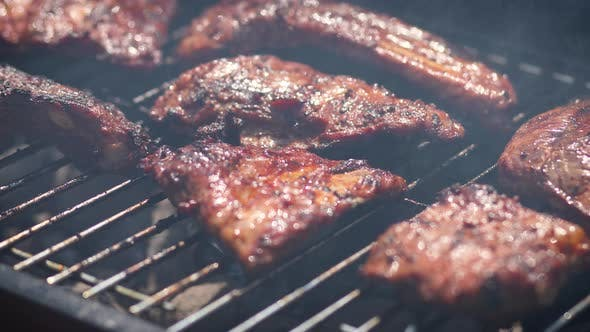 Thumbnail for Tasty Ribs Cooking on Barbecue Grill for Summer Outdoor Party