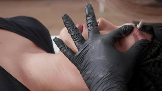 Thumbnail for Revealing Shot From Left To Right of a Customer During a Procedure at a Beauty Salon