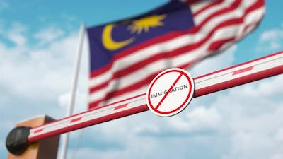 Barrier with No Immigration Sign Opened at Flag of Malaysia