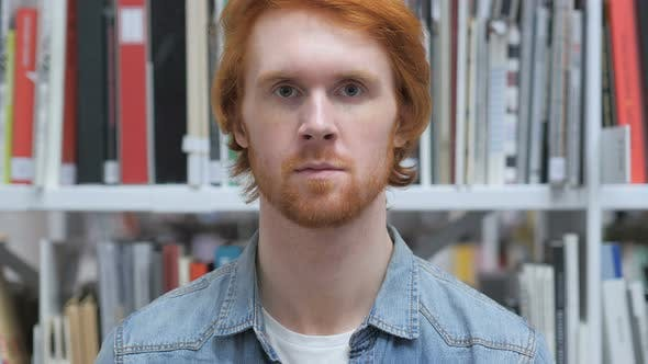 Thumbnail for Portrait of Beard Redhead Man in Library